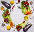 Organic garden vegetables ingredients, place for text,frame on wooden rustic background top view vegetarian concept Royalty Free Stock Photo