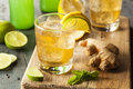 Organic ginger ale soda in a glass with lemon and lime Stock Photos