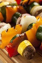 Organic grilled vegetable shish kebab with peppers mushrooms and onions Royalty Free Stock Photo