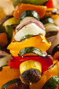 Organic grilled vegetable shish kebab with peppers mushrooms and onions Stock Photos