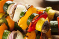 Organic grilled vegetable shish kebab with peppers mushrooms and onions Stock Images