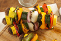 Organic grilled vegetable shish kebab with peppers mushrooms and onions Stock Image
