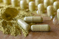 Organic Herbal drug capsule process. Royalty Free Stock Photo