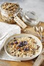 Organic homemade granola cereal with oats, nuts and dried berries. Muesli in a glass jar. Healthy vegan breakfast or snack. Copy Royalty Free Stock Photo