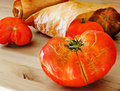Organic mature tomatoes in a ecological paper bag Stock Images