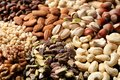 Organic mixed nuts as background, closeup. Royalty Free Stock Photo