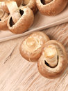 Organic mushrooms brown on a wooden bowl Stock Photos