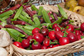 Organic okra and cherry peppers Stock Photo