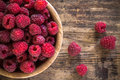 Organic raspberries in a bowl on wooden background bright fresh old Stock Images