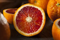 Organic raw red blood oranges on a background Stock Photos
