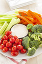 Organic raw vegetables with ranch dip tomatoes celery brocolli and carrots Royalty Free Stock Photos