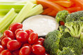 Organic raw vegetables with ranch dip tomatoes celery brocolli and carrots Stock Image