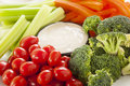 Organic raw vegetables with ranch dip tomatoes celery brocolli and carrots Stock Photography