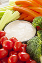 Organic raw vegetables with ranch dip tomatoes celery brocolli and carrots Stock Photo