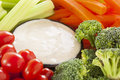 Organic raw vegetables with ranch dip tomatoes celery brocolli and carrots Royalty Free Stock Images