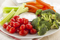Organic raw vegetables with ranch dip tomatoes celery brocolli and carrots Stock Photos