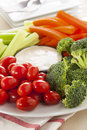 Organic raw vegetables with ranch dip tomatoes celery brocolli and carrots Royalty Free Stock Image