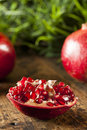 Organic ripe red pomegranates ready to eat Royalty Free Stock Images