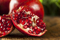 Organic ripe red pomegranates ready to eat Stock Images