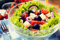 Organic salad fresh with vegetables and cheese selective focus in the middle of Stock Images