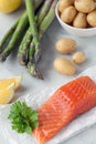 Organic salmon fillet potatoes asparagus shallow dof Stock Photos