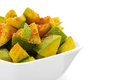 Organic sliced indian mango mangifera indica in white bowl seasoned with turmeric salt and red chili pepper isolated on Royalty Free Stock Photos