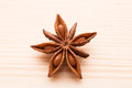Organic star anise on a wooden table close up Stock Images