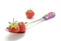 Organic strawberries in the spoon isolated red strawberry Stock Photo