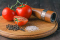 Organic tomatoes with papper, sea salt Royalty Free Stock Photo