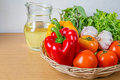 Organic vegetables in the wicker basket Royalty Free Stock Photo