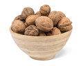 Organic walnuts in bowl wooden Stock Photography
