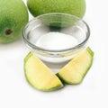 Organic whole and sliced indian mango mangifera indica with white salt isolated on white background front view Royalty Free Stock Image