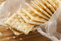 Organic whole wheat soda crackers ready to eat Stock Image