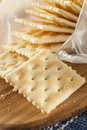Organic whole wheat soda crackers ready to eat Stock Photos
