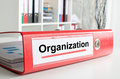 Organization wording on a binder the back of red Royalty Free Stock Photo