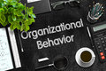 Organizational Behavior on Black Chalkboard. 3D Rendering. Royalty Free Stock Photo