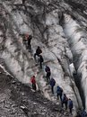 Organized commercial climbing franz josef glacier new zealand Royalty Free Stock Images