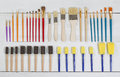 Organized new paintbrushes and applicators on white wooden board high angled view of brand paint brushes wood layout in horizontal Stock Photography