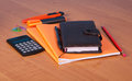 Organizer, notebook, pen, pencil, marker, cutter and calculator on desktop. Royalty Free Stock Photo