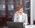 Oriental business people make a phone call woman is using cell smiling Royalty Free Stock Photo