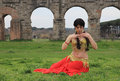 Oriental dancer beautiful belly under the roman aqueduct Stock Images