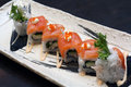 Oriental delicacy dai dai roll spicy crab meat sushi topped with salmon and shrimp roe Stock Photography
