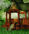 Oriental gazebo on a meadow colorful spring Stock Photo