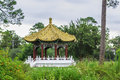 Oriental gazebo a porch located near an overgrown garden Royalty Free Stock Images