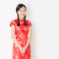 Oriental girl in red qipao portrait of young asian woman traditional dress smiling celebrating chinese lunar new year or spring Stock Image