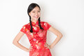 Oriental girl in red qipao smiling portrait of young asian traditional dress celebrating chinese lunar new year or spring festival Royalty Free Stock Photo