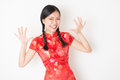 Oriental girl in red qipao surprised portrait of young asian traditional dress with face expression celebrating chinese lunar new Stock Image