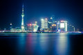 The oriental pearl tower at night in shanghai huangpu river Stock Photo