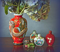 Oriental vase with dragon and perfume bottles Royalty Free Stock Image
