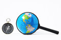 Orientation concept earth magnify glass and compass on a white background Stock Images